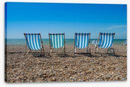 Deck chairs on Brighton beach, England