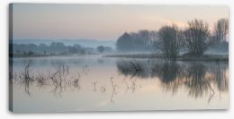 Sunrise glow over misty lake Stretched Canvas 62523389