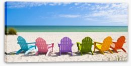 Rainbow chairs on a sunny beach Stretched Canvas 65357803