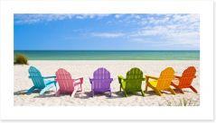 Rainbow chairs on a sunny beach