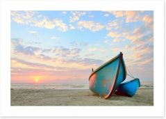 Blue boats at sunrise