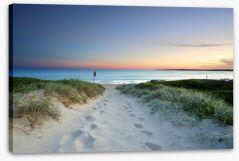 Sandy beach trail at sundown Stretched Canvas 75746716