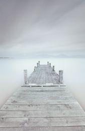 Pier on the frozen lake