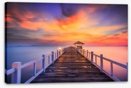 Fiery sunset across the pier Stretched Canvas 61181973