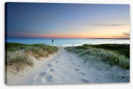 Sandy beach trail at sundown Stretched Canvas 75746716