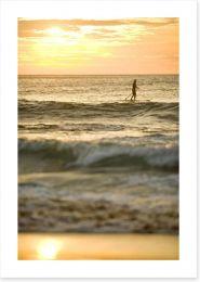 Avalon beach paddle boarder at sunrise
